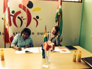 Representatives from the LGBT Platform of Suriname signing a Human Rights Grant, being handed over by the Canadian Ambassador